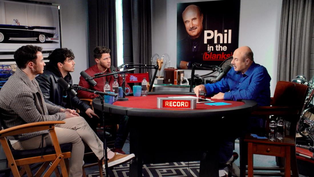 The Jonas Brothers being interviewed by Dr. Phil