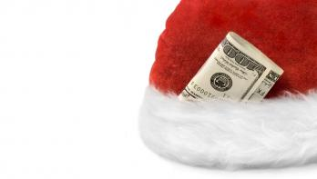 santa hat with hundred dollar bill