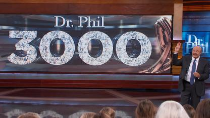 Dr. Phil on stage in front of the audience.