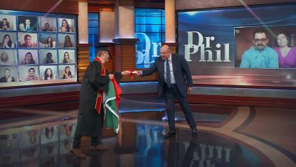 Dr. Phil on stage with a guest.