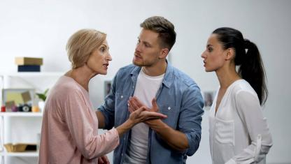A woman disagreeing with a man and a younger woman