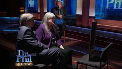 Photo of two parents on Dr. Phil's stage.