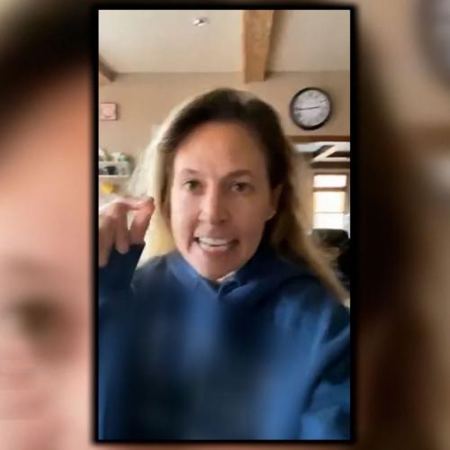 An image of a woman from a cell phone video