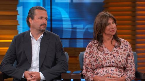 Man and woman on Dr. Phil's stage
