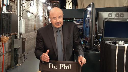 Dr. Phil talking to camera backstage