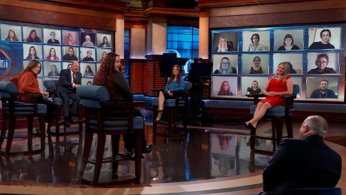 Four women sitting on Dr. Phil's stage speaking to a man in the audience.