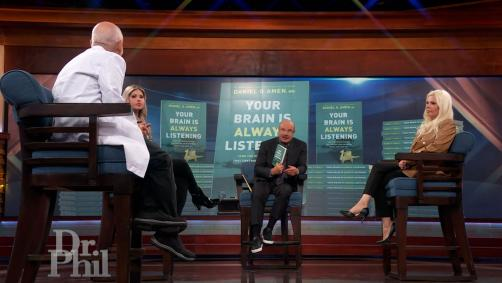 Dr. Phil speaking to a mother and daughter along with Dr. Daniel Amen